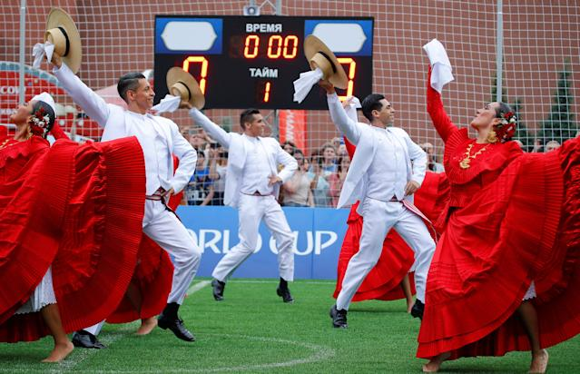 Participants perform during the Peru Day event in the soccer World Cup Football Park in Red Square in central Moscow, Russia June 24, 2018. REUTERS/Sergei Karpukhin