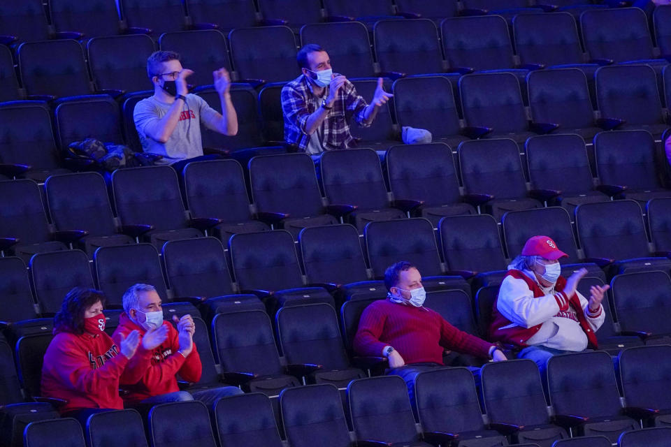 St. John's fans cheer on during the first half of an NCAA college basketball game against Seton Hall in the quarterfinals of the Big East conference tournament, Thursday, March 11, 2021, in New York. (AP Photo/Mary Altaffer)