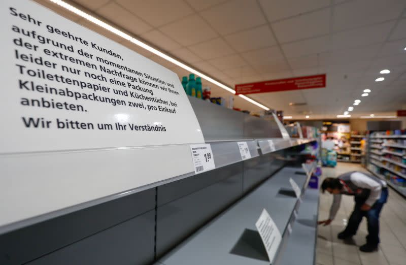 FILE PHOTO: A sign announces the rationing of toilet paper to one pack per person at a Rewe grocery store in Potsdam