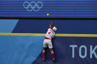 Japan's Yuka Ichiguchi (4) jumps but can't get to the home run ball hit by United States' Kelsey Stewart to win the game in the seventh inning of a softball game at the 2020 Summer Olympics, Monday, July 26, 2021, in Yokohama, Japan. (AP Photo/Sue Ogrocki)