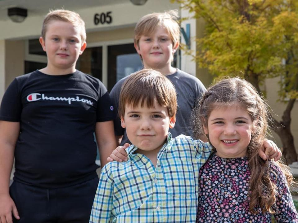 Cody and Levi Clark, rear, and Logan and Aurora Dawson, front, are two of the six sets of twins currently attending Parkview Elementary School in Sicamous, B.C.  (Andrew Lee/CBC  - image credit)
