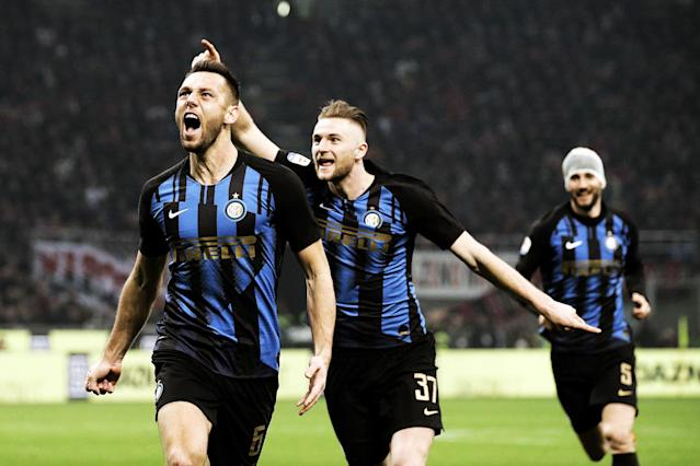 Stefan De Vrij, left, celebrates his goal for Inter Milan on Sunday. (Getty)