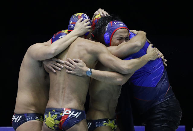 Philippines' water polo team embrace after their game against Singapore at the 30th South East Asian Games in New Clark City, Tarlac province, northern Philippines on Friday, Nov. 29, 2019. Philippines scored a draw against Singapore 6-6. (AP Photo/Aaron Favila)