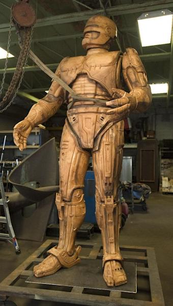 A foam model of the the fictional crime-fighting cyborg RoboCop statue stands inside Venus Bronze Works in Detroit, on Tuesday, Sept. 24, 2013. Venus Bronze Works in Detroit is getting ready to cast pieces of the statue. After this model is turned into a mold, the finished statue is set to be unveiled in summer of 2014. The 1980s science fiction movie was set in a futuristic and crime-ridden Detroit. (AP Photo/The Detroit News, David Guralnick )