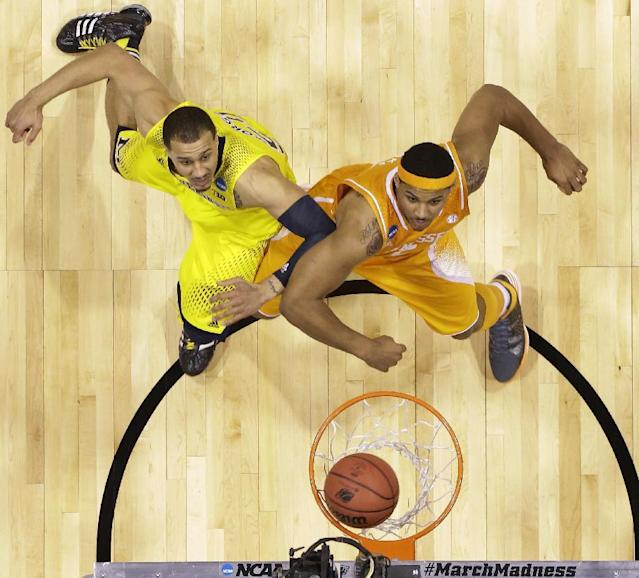 Michigan's Jordan Morgan, left, and Tennessee's Jarnell Stokes watch a shot go in during the first half of an NCAA Midwest Regional semifinal college basketball tournament game Friday, March 28, 2014, in Indianapolis. (AP Photo/Michael Conroy)