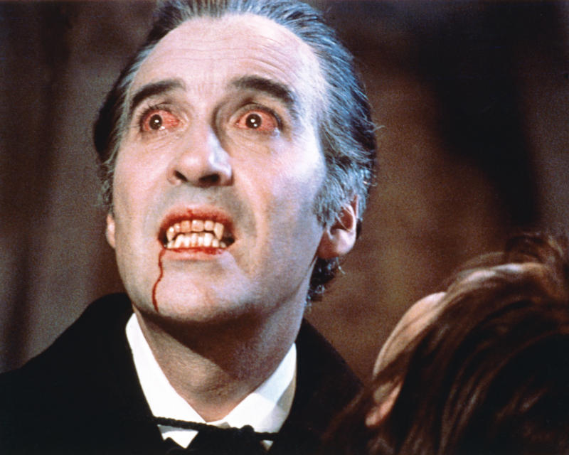 Christopher Lee, British actor, with bloodshot eyes and wearing pale facepaint and vampire's fangs in a publicity still issued for the flilm, 'Dracula', 1958. The Hammer horror film, directed by Terence Fisher (1904–1980), starred Lee as 'Dracula'. (Photo by Silver Screen Collection/Getty Images)