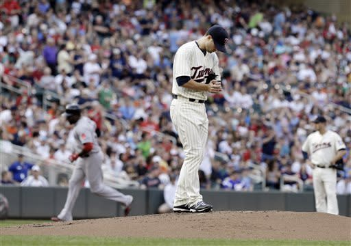 Minnesota Twins pitcher Scott Diamond looks down at the mound as Boston Red Sox's David Ortiz, left, runs the bases on his three-run home run off Diamond in the first inning of a baseball game, Saturday, May 18, 2013, in Minneapolis. (AP Photo/Jim Mone)