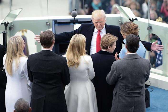 US President Donald Trump embraces his family after giving his first speech as the 45th US president in front of the Capitol in Washington on January 20, 2017 (AFP Photo/Brendan SMIALOWSKI)