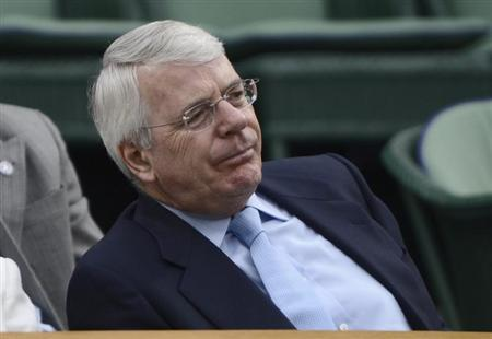Former British Prime Minister, John Major, sits on Centre Court for the men's singles tennis match between Novak Djokovic of Serbia and Radek Stepanek of the Czech Republic at the Wimbledon tennis championships in London