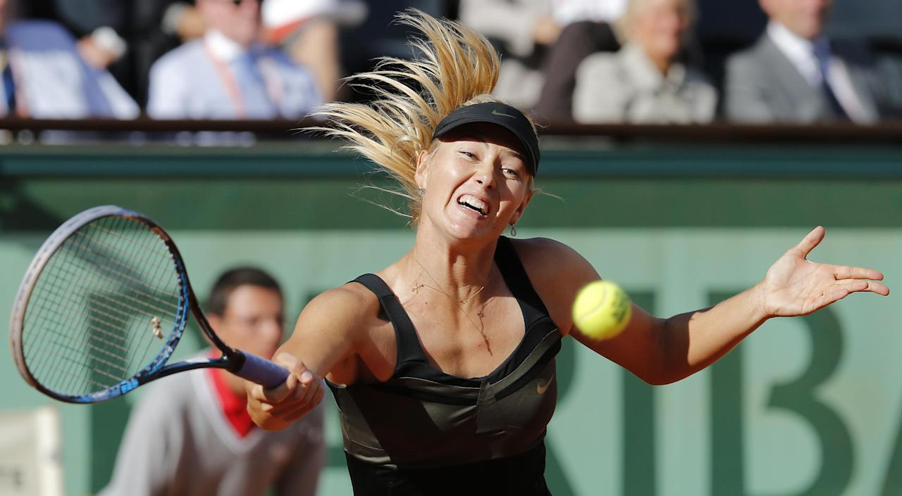 Maria Sharapova of Russia returns in her semi final match against Petra Kvitova of the Czech Republic at the French Open tennis tournament in Roland Garros stadium in Paris, Thursday June 7, 2012. Sharapova won in two sets 6-3, 6-3. (AP Photo/Michel Euler)
