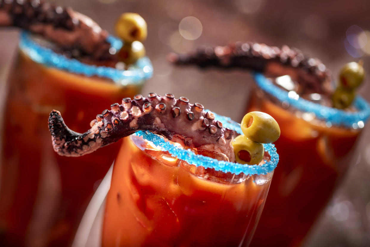 It's a Squid's Revenge! This michelada is rimmed with blue salt and garnished with a charred octopus tentacle. (Photo: Walt Disney World Resort)