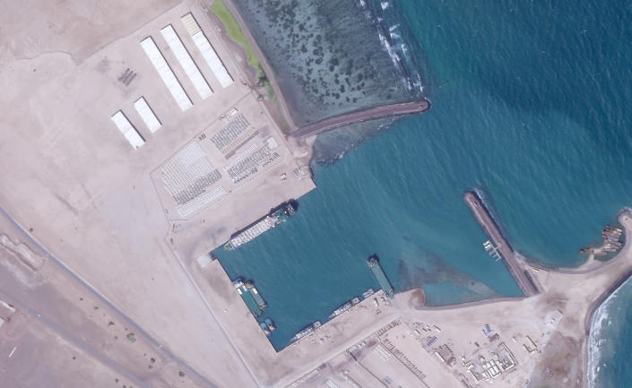 A Jan. 7, 2021, satellite photo from Planet Labs Inc. shows what appears to be vehicles and other material being loaded onto a ship at a port at an Emirati military base in Assab, Eritrea. The United Arab Emirates is dismantling parts of a military base it runs in the East African nation of Eritrea after it pulled back from the grinding war in nearby Yemen, satellite photos analyzed by The Associated Press show. (Planet Labs Inc. via AP)