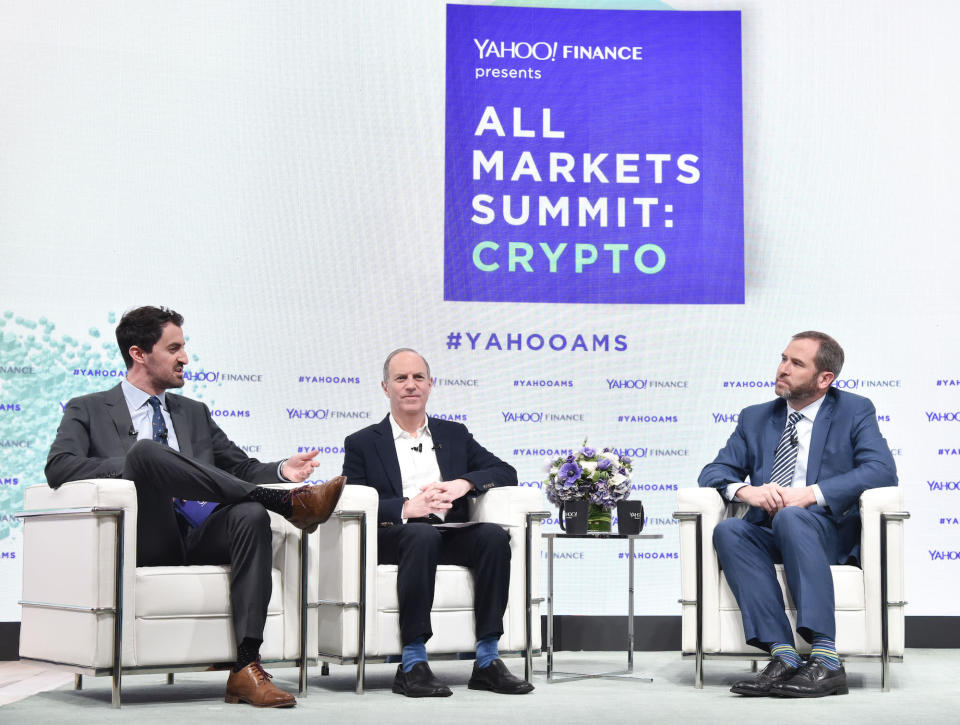 Talking crypto: Dan Roberts, Brad Garlinghouse, and Andy Serwer attend the Yahoo Finance All Markets Summit: Crypto on February 7, 2018 in New York City. Photo: Eugene Gologursky/Getty Images for Yahoo Finance/Oath.