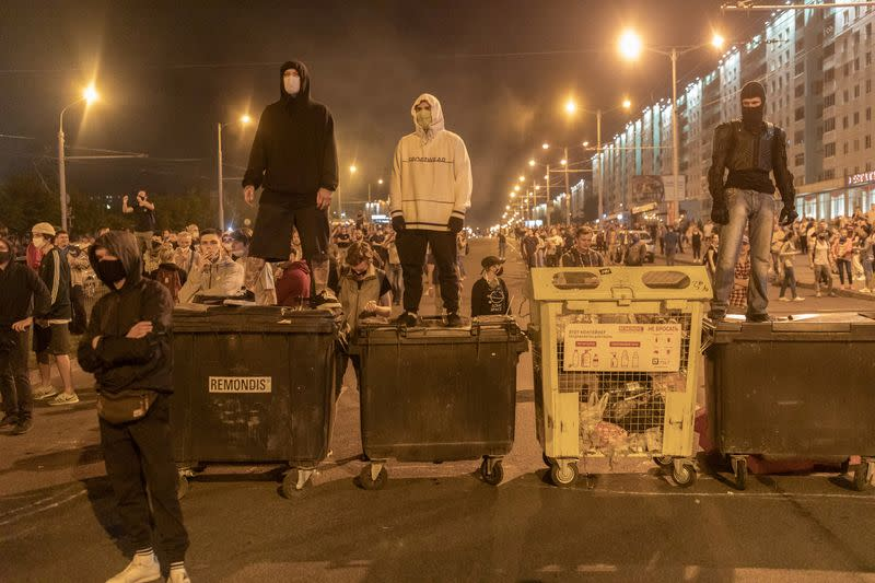 New clashes as opposition leader flees Belarus citing children's safety