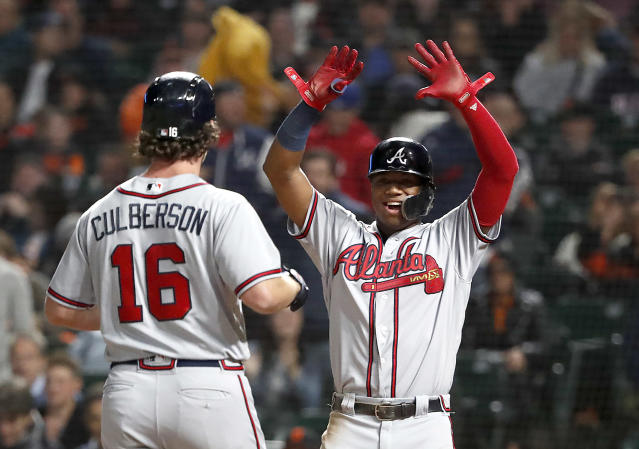 Atlanta Braves' Charlie Culberson (16) celebrates with teammate Ronald Acuna Jr., right, after hitting a two run home run against the San Francisco Giants during the fifth inning of a baseball game in San Francisco, Tuesday, Sept. 11, 2018. (AP Photo/Tony Avelar)