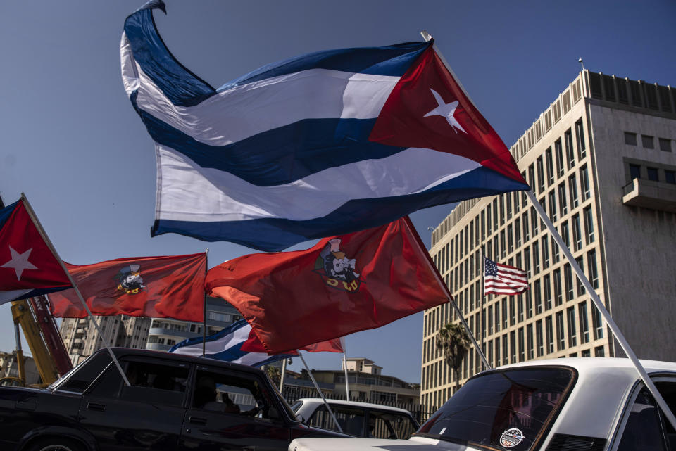 Soviet-era Ladas flying Cuban flags are driven past the U.S. embassy during a rally calling for the end of the U.S. blockade against the island nation in Havana, Cuba, Sunday, March 28, 2021. Lada's are the island's most visible Soviet-era legacy. (AP Photo/Ramon Espinosa)