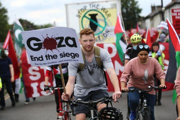Pro-Palestine protesters march against the Defence and Security Equipment International (DSEI) fair on 12 September. (Photo: Anadolu Agency via Getty Images)