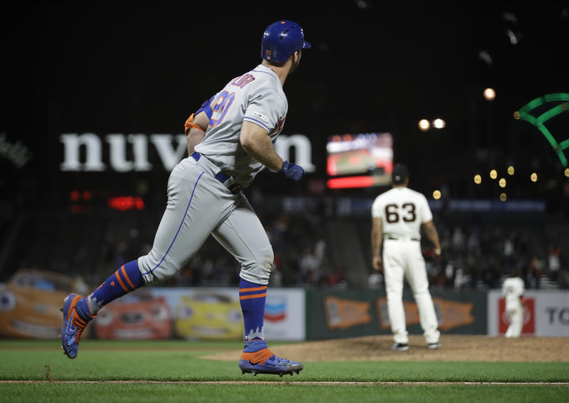 New York Mets' Pete Alonso, left, watches his home run off San Francisco Giants' Williams Jerez (63) in the 16th inning of a baseball game Thursday, July 18, 2019, in San Francisco. (AP Photo/Ben Margot)
