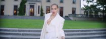 <p>Wearing a rare red lip, J.Lo goes all white in this power suit.</p>