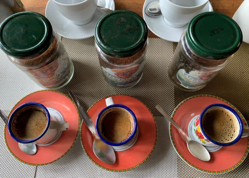 Mixed cups of coffee samples are seen at the Kafen Drazana packaging of the Bourbon pointu coffee variety in Ampefy town of Itasy region