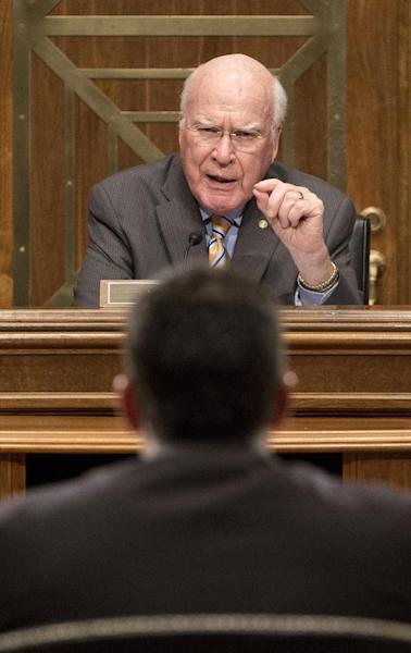 """Senate subcommittee on State, Foreign Operations and Related Programs Chairman Sen. Patrick Leahy, D-VT., top, questions US Agency for International Development (USAID) Administrator Dr. Rajiv Shah, bottom, on Capitol Hill in Washington, Tuesday, April 8, 2014, during the committee's hearing of the USAID's fiscal 2015 budget. Leahy demanded to know who came up with the idea to launch a secret """"Cuba Twitter"""" social network system. Speaking at the subcommittee hearing, Leahy called the project """"cockamamie."""" (AP Photo/Pablo Martinez Monsivais)"""