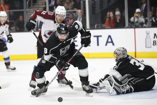 Los Angeles Kings' Drew Doughty, left, looks at the puck deflected by goaltender Jonathan Quick during the first period of an NHL hockey game against the Colorado Avalanche Monday, April 2, 2018, in Los Angeles. (AP Photo/Jae C. Hong)