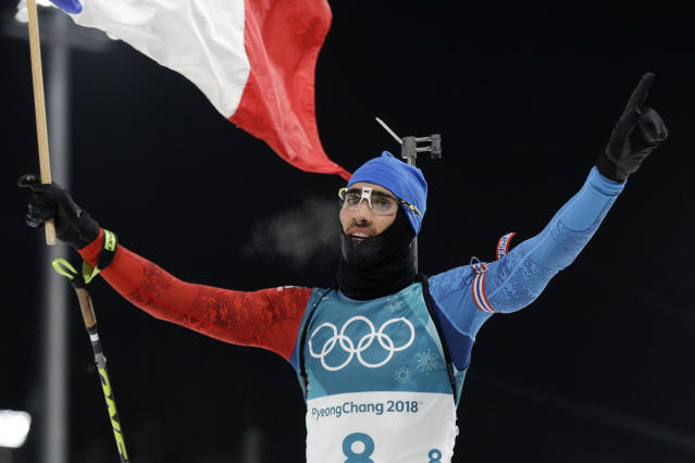 <p>Martin Fourcade of France took gold in the men's 12.5-kilometer biathlon pursuit. Sebastian Samuelsson of Sweden took silver and Germany's Benedikt Doll took bronze. (AP) </p>