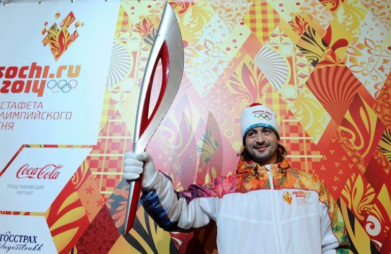 Ilia Averbukh holds the newly unveiled Sochi 2014 Olympic Torch during a press conference in Moscow, on January 14, 2013