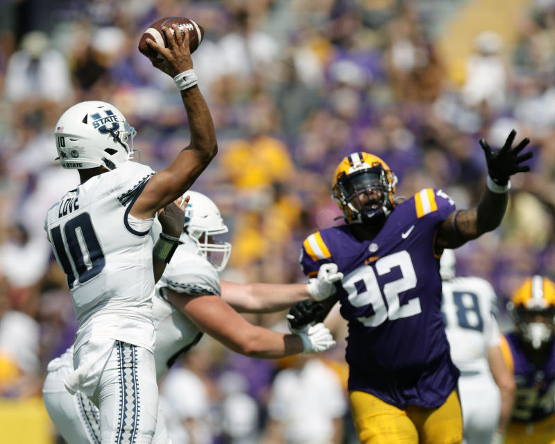 Utah State QB Jordan Love made a few big throws early before fading. (Getty Images)
