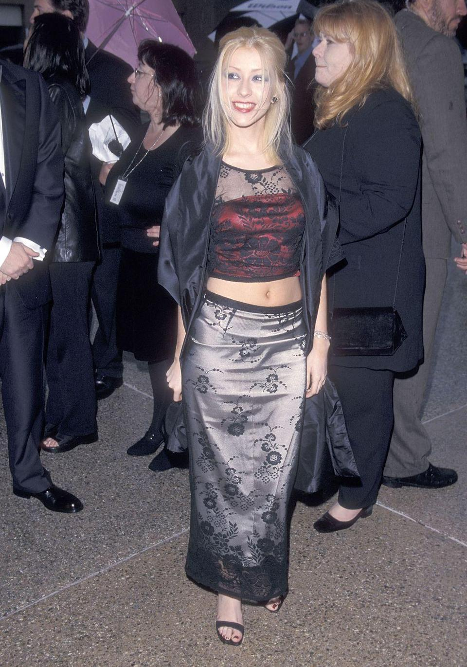 <p>No one can say X-tina didn't keep things interesting in the '90s. At the ALMA Awards, she showed up in this lacy crop top and maxi skirt combo, and you know what? It's one of her more tame looks.</p>