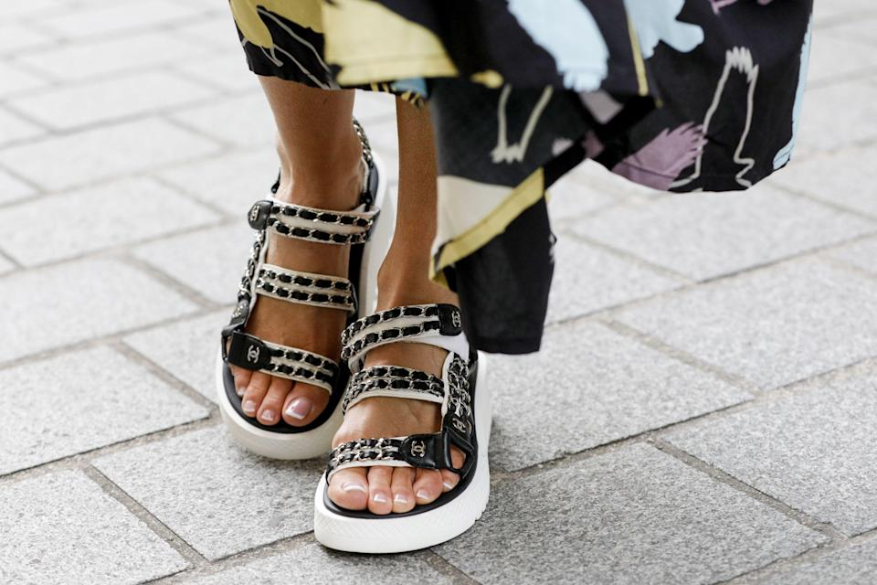 "<p class=""body-dropcap"">If you're emerging from lockdown in a bit of a style rut, we know the perfect footwear trend to get you back on your feet: the chunky sandal. Popping up all over our feeds in recent weeks thanks to our favorite influencers, the chunky sandal elevates any look from the feet up. You'll want to walk a mile in these shoes—and for good reason. Not only is the style chic, it's comfortable. Pro tip: Do as we do and style yours with an anklet and the perfect summer suit. Ahead, more styling inspiration and the hottest pairs of chunky sandals to shop before this season sets sail.<br></p>"