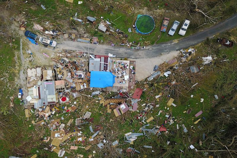 A house destroyed by hurricane winds is seen in Corozal, west of San Juan, Puerto Rico, on Sept. 24 following the passage of Hurricane Maria. (RICARDO ARDUENGO via Getty Images)