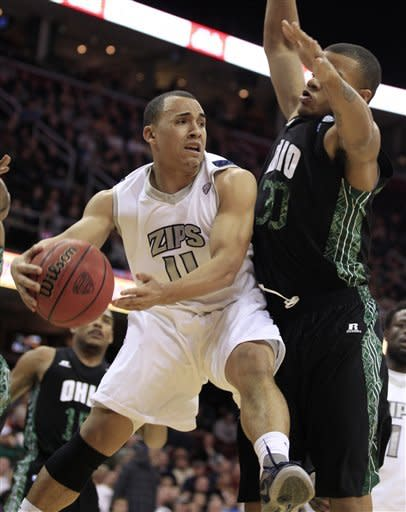 Akron's Alex Abreu (11) tries to get past Ohio's Reggie Keely (30) in the first half during an NCAA college basketball championship game in the Mid-American Conference men's tournament on Saturday, March 10, 2012, in Cleveland. (AP Photo/Tony Dejak)