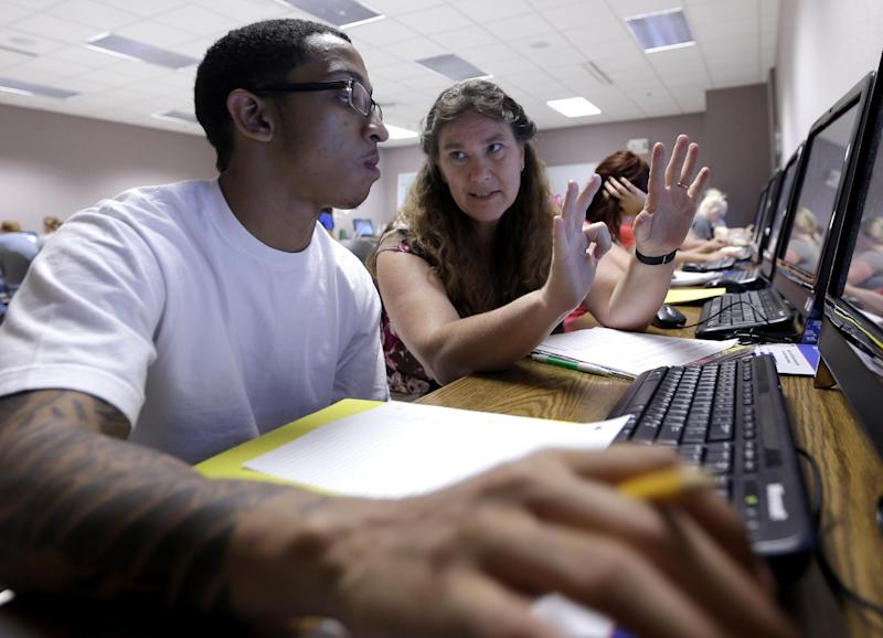 Math teacher Thora Broyles, right, counts on her fingers in an effort to help student Jamal Mabry in a remedial math class Tuesday, Aug. 28, 2012, at Missouri State University-West Plains in West Plains, Mo. At the two-year school in south-central Missouri, fully 75 percent of first-year students take at least one remedial class, well above the national average of 50 percent at community colleges and 20 percent at four-year schools. (AP Photo/Jeff Roberson)