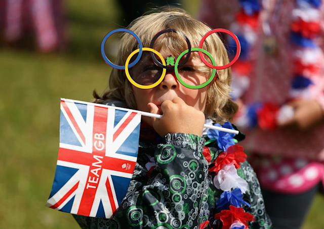 LONDON, ENGLAND - JULY 29: A young fan watches on during the Women's Road Race Road Cycling on day two of the London 2012 Olympic Games on July 29, 2012 in London, England (Photo by Streeter Lecka/Getty Images)