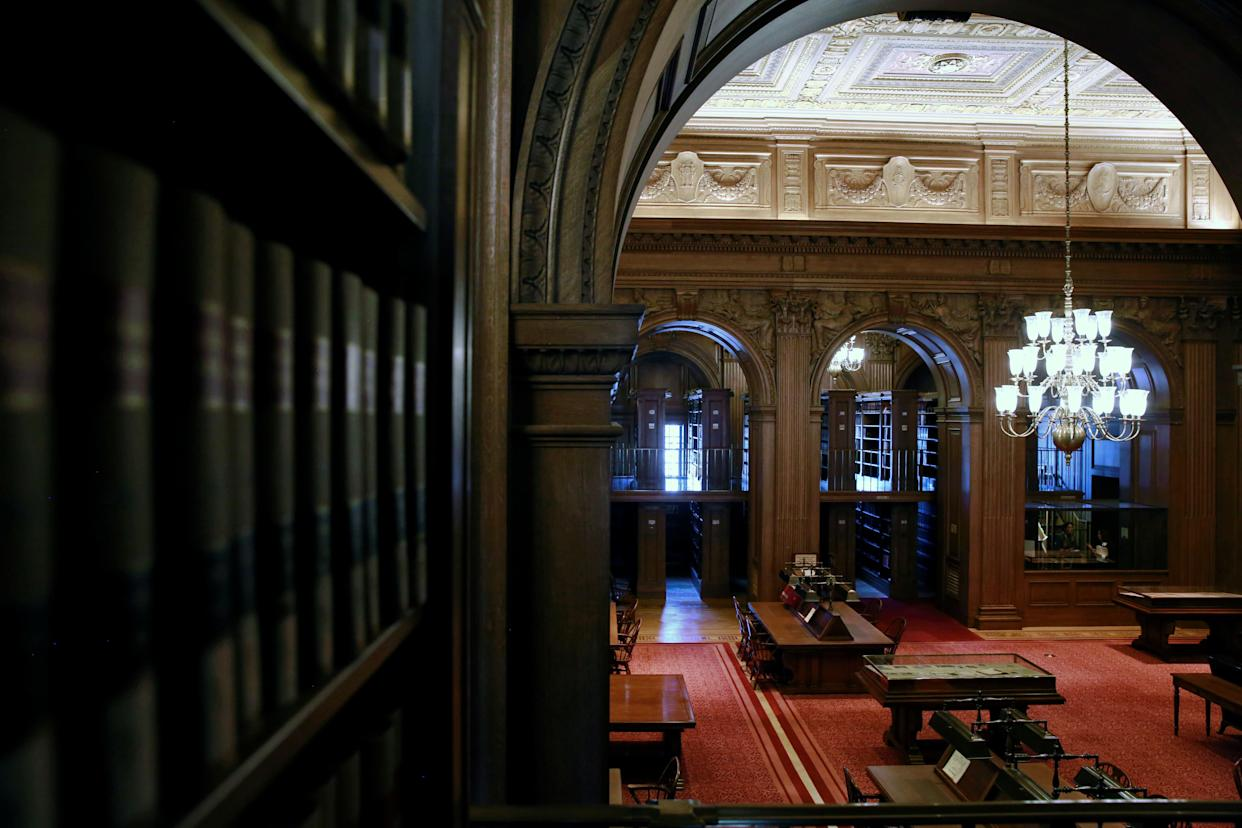 Carved oak walls and arches are seen in the reading area of the library at the U.S. Supreme Court in Washington, U.S. April 4, 2016.