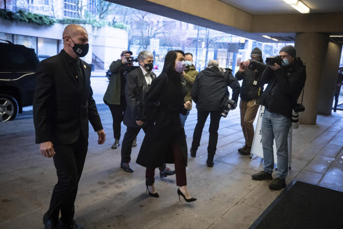 Chief Financial Officer of Huawei, Meng Wanzhou, arrives at British Columbia Supreme Court, in Vancouver, British Columbia, Friday, March 19, 2021. (Darryl Dyck/The Canadian Press via AP)