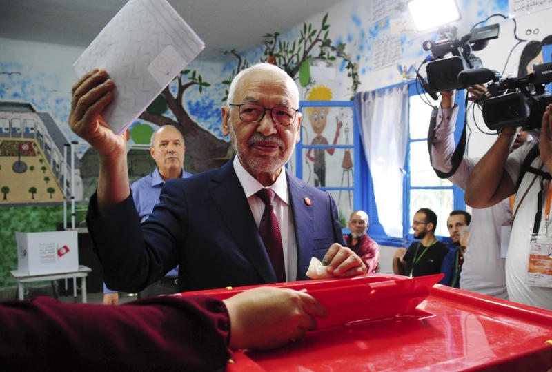 President of the Islamist party Ennahda and candidate for the Parliamentary election Rached Ghannouchi votes in a polling station south of Tunis, Tunisia, Sunday, Oct. 6, 2019. Tunisians are electing a new parliament Sunday amid a tumultuous political season, with a moderate Islamist party and a jailed tycoon's populist movement vying to come out on top of a crowded field. (AP Photo/Hassene Dridi)