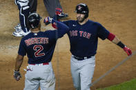 Boston Red Sox's J.D. Martinez, right, celebrates with teammate Xander Bogaerts after hitting a home run during the eighth inning of a baseball game against the New York Yankees Friday, July 16, 2021, in New York. (AP Photo/Frank Franklin II)