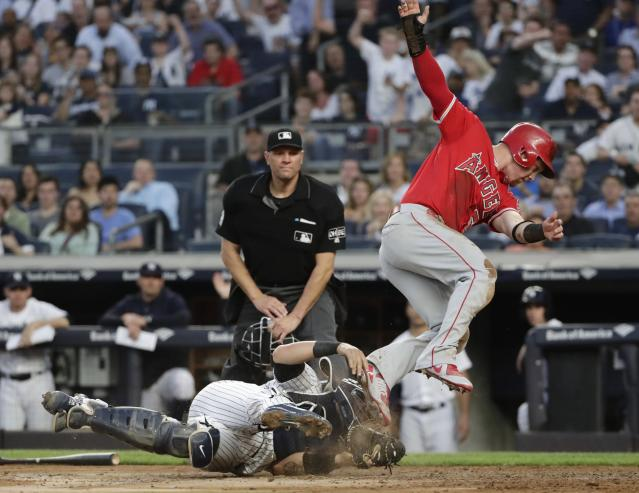 New York Yankees catcher Gary Sanchez, left, holds on to the ball after tagging out Los Angeles Angels' Kole Calhoun during the third inning of a baseball game Friday, May 25, 2018, in New York. (AP Photo/Frank Franklin II)