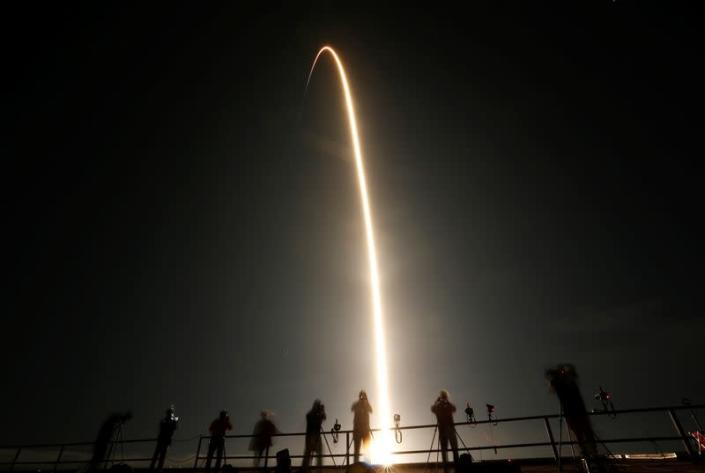 SpaceX Falcon 9 rocket, topped with Crew Dragon capsule, is launched carrying four astronauts on the first operational NASA commercial crew mission at Kennedy Space Center in Cape Canaveral