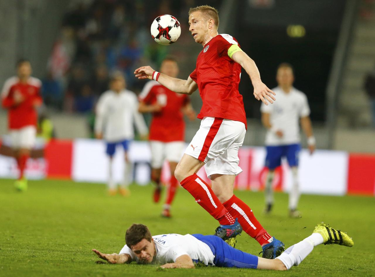 Football Soccer - Austria v Finland - International Friendly - Tivoli Stadium, Innsbruck, Austria - 28/3/17 - Austria's Marc Janko and Finland's Sauli Vaisanen in action. REUTERS/Dominic Ebenbichler