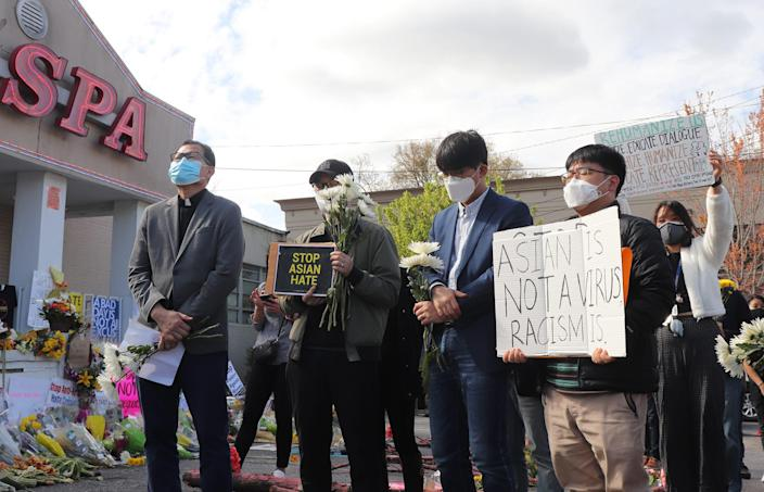Image:; Asian American church leaders held a vigil Sunday in front of the Gold Spa in Atlanta. (Hanna Park)
