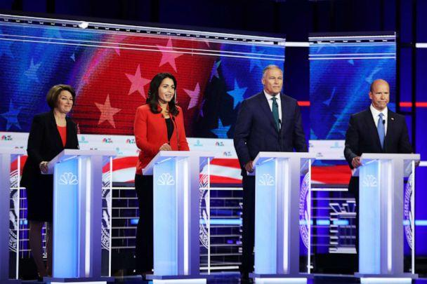 PHOTO: Sen. Amy Klobuchar (D-MN), Rep. Tulsi Gabbard (D-HI), Washington Gov. Jay Inslee and former Maryland congressman John Delaney take part in the first night of the Democratic presidential debate on June 26, 2019 in Miami, Florida. (Joe Raedle/Getty Images)