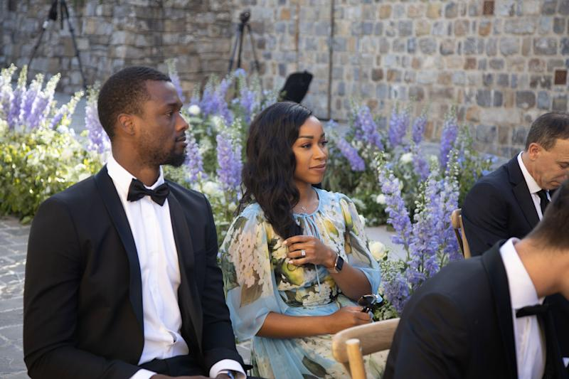 Sacramento Kings NBA player Harrison Barnes and his wife Brittany watching the ceremony.