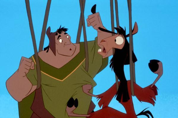 Pach (voiced by John Goodman) and Kuzco (David Spade) are fighting while suspended by ropes.