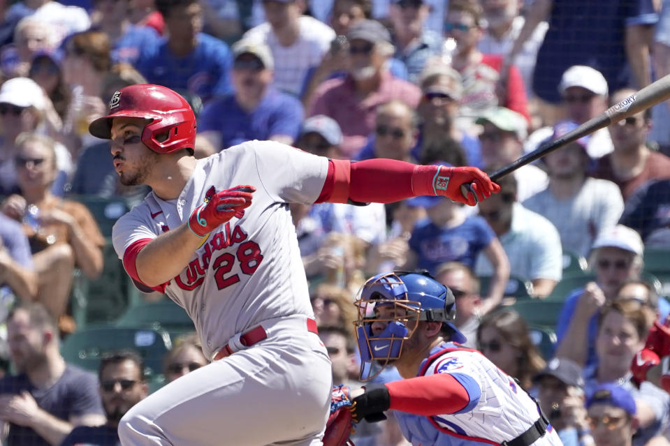 St. Louis Cardinals' Nolan Arenado hits a two-run single during the fifth inning of a baseball game against the Chicago Cubs, Friday, June 11, 2021, in Chicago. (AP Photo/Charles Rex Arbogast)