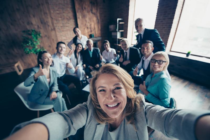 Self-portrait above high angle view of nice stylish cheerful glad positive director company staff showing thumbsup yes goal achievement recommend modern industrial loft interior work place open space.