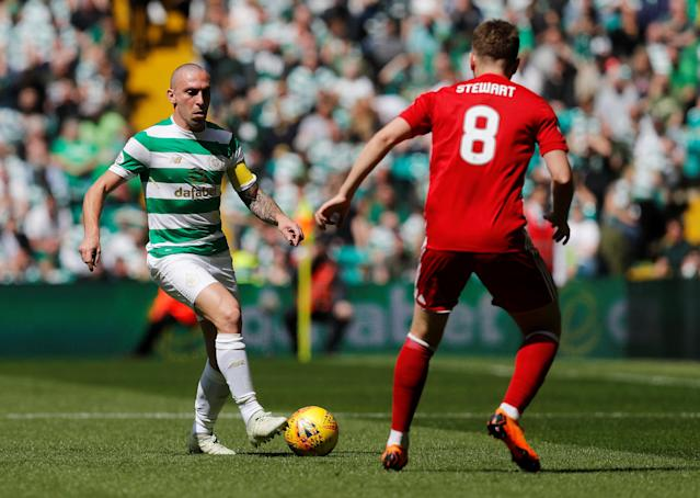 Soccer Football - Scottish Premiership - Celtic vs Aberdeen - Celtic Park, Glasgow, Britain - May 13, 2018 Celtic's Scott Brown in action with Aberdeen's Greg Stewart REUTERS/Russell Cheyne
