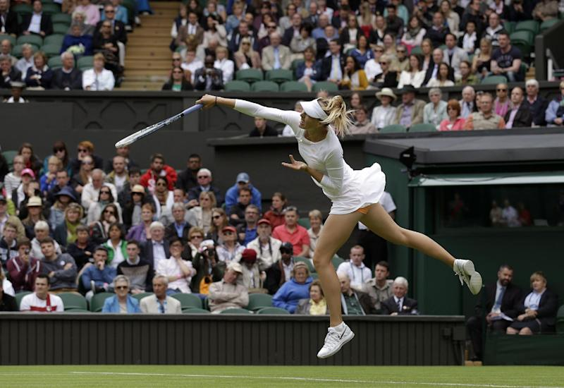Maria Sharapova of Russia serves to Kristina Mladenovic of France during their Women's first round singles match at the All England Lawn Tennis Championships in Wimbledon, London, Monday, June 24, 2013. (AP Photo/Anja Niedringhaus)